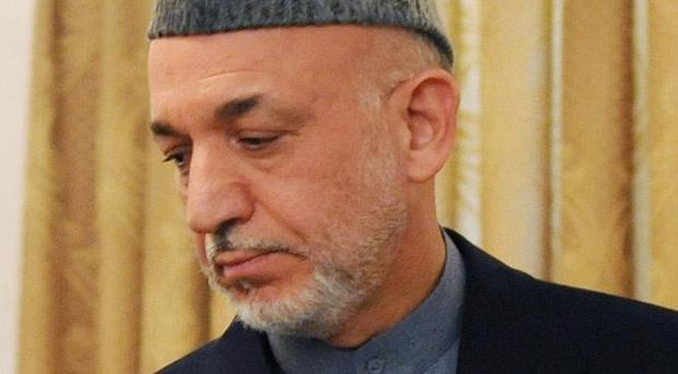 Afghanistan President Hamid Karzai has been accused of freeing criminals because they had connections to powerful figures