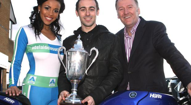 Current Irish Motorcyclist of the Year Eugene Laverty at the launch of the 2011 Adelaide Irish Racer Awards with Miss NI Lori Moore and Sam Geddis of Adelaide Ins. Services