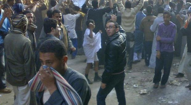 Muslim Brotherhood supporters take to the streets to protest against Sunday's parliamentary elections in Egypt