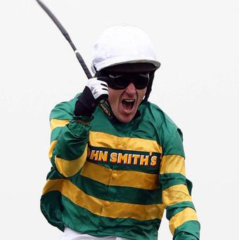 Tony McCoy celebrates winning the John Smith's Grand National on Don't Push It