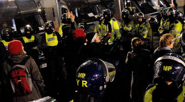 Police contain a few remaining student protesters near Trafalgar Square, in central London