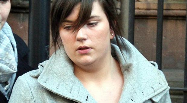 Catriona Dobbin leaves the coroners court in Belfast, where an inquest into the death of fiancee Graeme Nixon took place