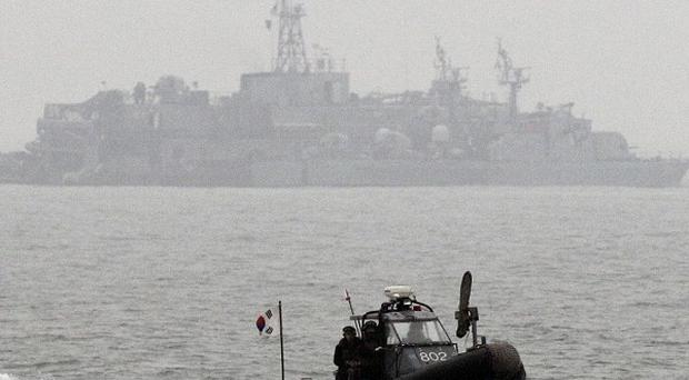South Korean sailors approach a port in Yeonpyeong Island (AP)