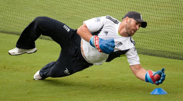 England wicketkeeper Matt Prior shows off his skills during a nets session at Adelaide Oval yesterday