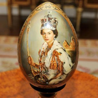 An ornate wooden egg which His Excellency the Ambassador of Ukraine Mr Volodymyr Khandogiy, presented as a gift to the Queen
