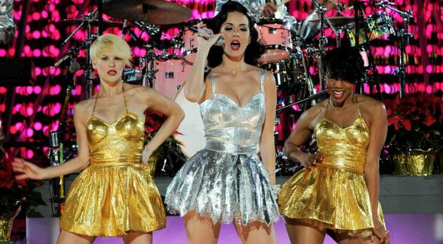 LOS ANGELES, CA - NOVEMBER 30: Singer Katy Perry (C) performs onstage at the GRAMMY Nominations Concert Live! at the Club Nokia on November 30, 2010 in Los Angeles, California. (Photo by Kevin Winter/Getty Images)