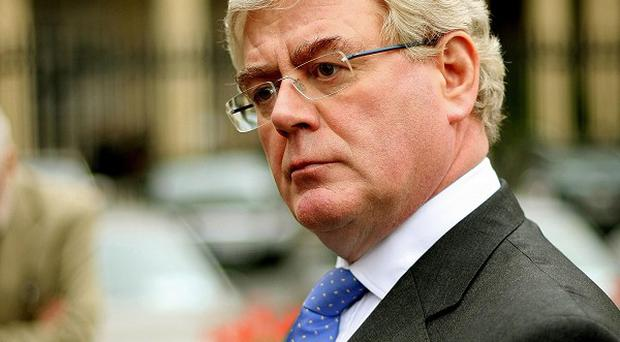 Labour leader Eamon Gilmore claims slashing the minimum wage by one euro will mean an increase in social benefit payments