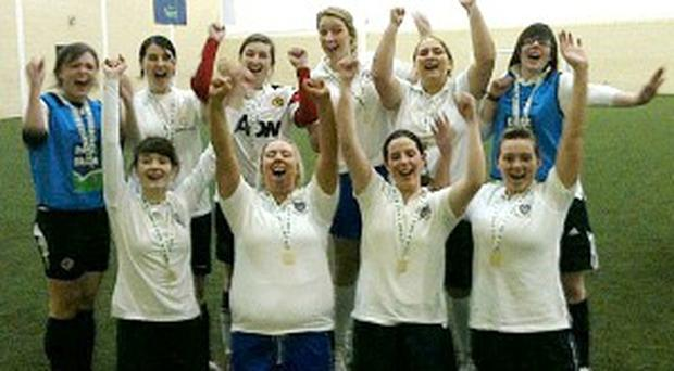 Stranmillis Ladies celebrate their decisive victory over the Queen's A side to take the Dale Farm championship