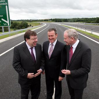 Transport Minister Conor Murphy (centre), with Brian Cowen (left) and Martin McGuinness at the opening of the road