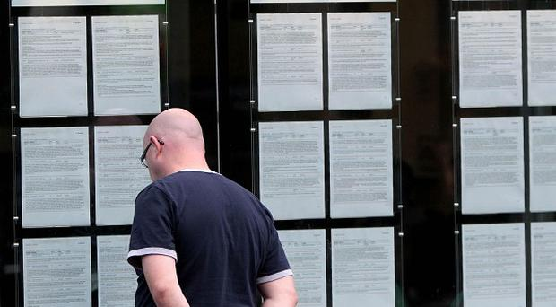 A man looks in the window at a FAS employment centre in Dublin as it emerged the unemployment figure fell for the third month in a row