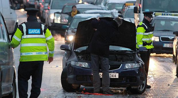 Gardai help motorists deal with icy roads along North Strand in central Dublin