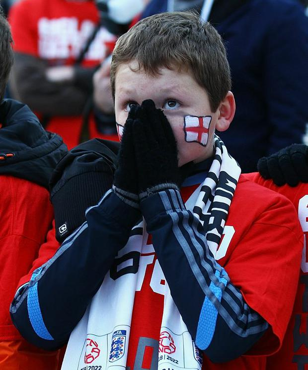 Children from St Johns School in Manchester show their disappointment after the announcement of the FIFA World Cup