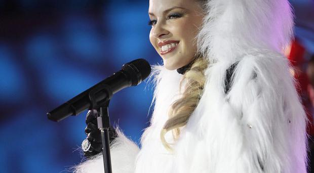 Kylie Minogue, wrapped in a furry coat, brought festive glamour to New York