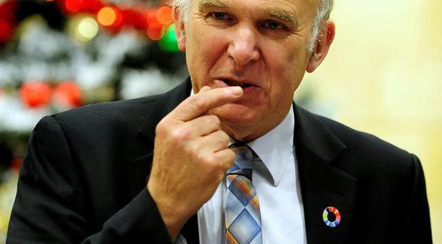 Confusion surrounds Business Secretary Vince Cable's position on voting for a rise in university tuition fees