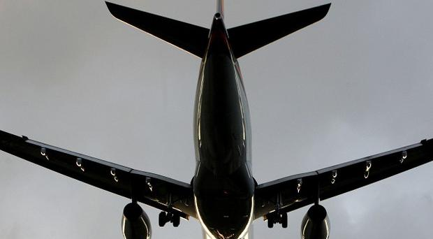 Transport Secretary Philip Hammond hinted a ban on carrying liquids in hand luggage will be eased