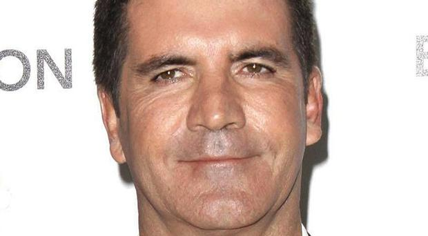 Simon Cowell is now in Who's Who