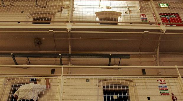 A convict has exposed a series of damning prison failures by using a mobile phone