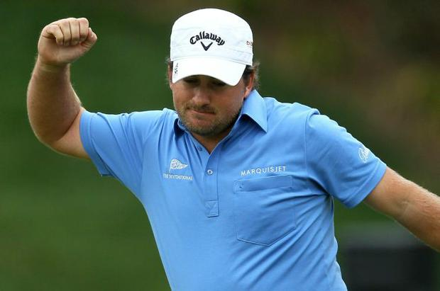 Graeme McDowell of Northern Ireland celebrates his birdie putt on the final hole of regulation to force a playoff with Tiger Woods during the final round of the Chevron World Challenge at Sherwood Country Club on December 5, 2010 in Thousand Oaks, California.