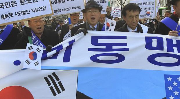 South Korean conservative activists shout slogans during a rally denouncing North Korea's attack in Seoul (AP)