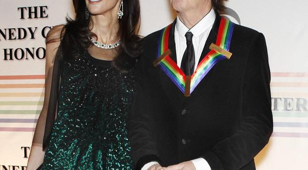 Nancy Shevell, left, and Paul McCartney pose on the red carpet at the Kennedy Centre Honours, in Washington (AP)