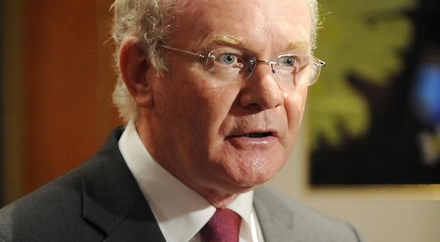 Northern Ireland's Deputy First Minister Martin McGuinness wants to meet the Prime Minister over the budget
