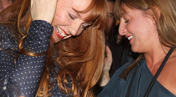 Artist Susan Philipsz (left) reacts after being named as the winner of the Turner Prize 2010