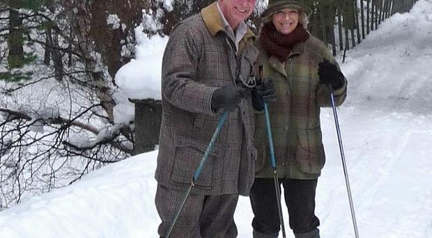 The Prince of Wales and Duchess of Cornwall's Christmas card shows the couple skiing