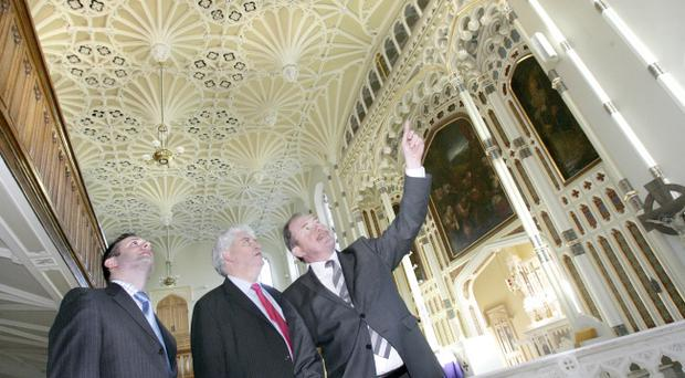 Ben Collins, RICS NI director at last year's Project of the Year, St Malachy's Church in Belfast, with South Belfast MP Alasdair McDonnell (centre) and Alistair Dunn (right) chairman of the judging panel