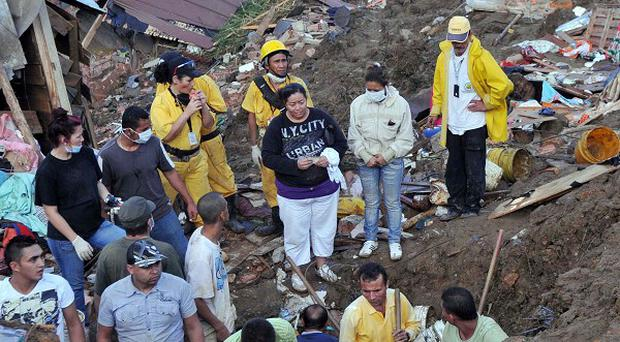 Residents search for survivors in Bello, northwestern Colombia, after the landslide