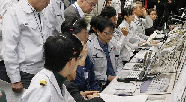Staff at Japan's Aerospace Exploration Agency monitor the Venus probe Akatsuki