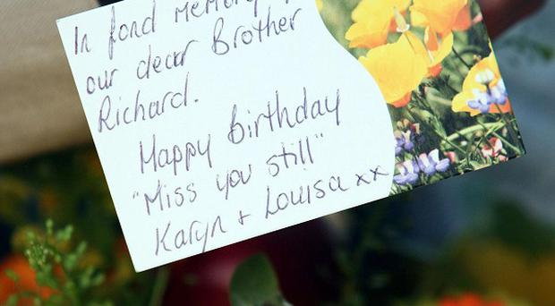 A card placed with flowers at the Royal Victoria Hospital in Belfast by Karyn Jackson and her sister Louisa