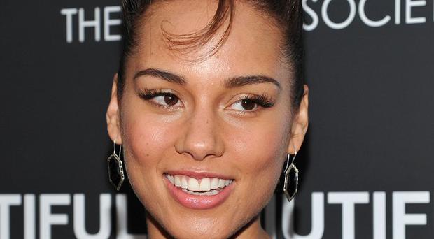 Alicia Keys has reached a one million dollar target for her charity