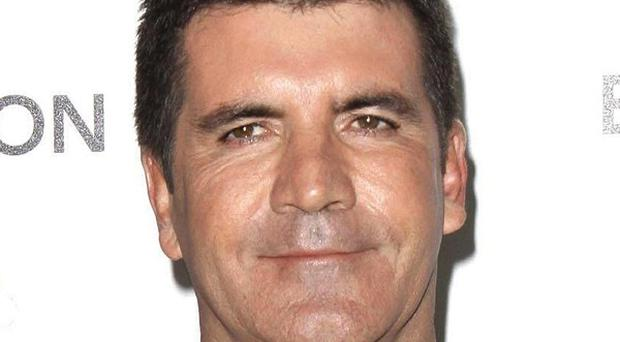 Simon Cowell has defended The X Factor semi final result