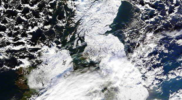 A satellite image reveals a picture of a snow and ice-covered Britain