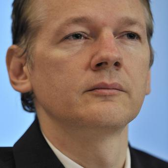 Julian Assange has called on the world 'not to shoot the messenger'