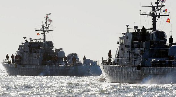 South Korean Navy ships sail near Yeonpyeong Island where two people died during the shelling