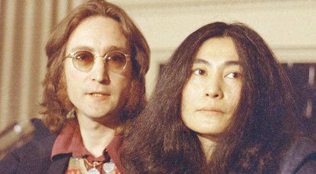 Former Beatle John Lennon and his wife, Yoko Ono, speak at a news conference in New York City, in this April 2, 1973