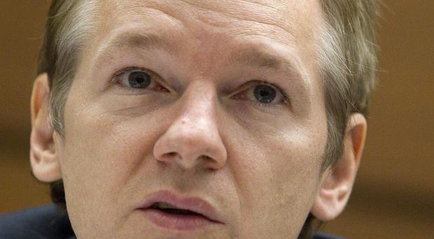 WikiLeaks founder Julian Assange has vowed to fight attempts to extradite him to Sweden (AP)