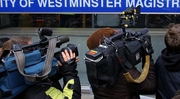 Media outside Westminster Magistrates' Court in London ahead of the appearance of Julian Assange