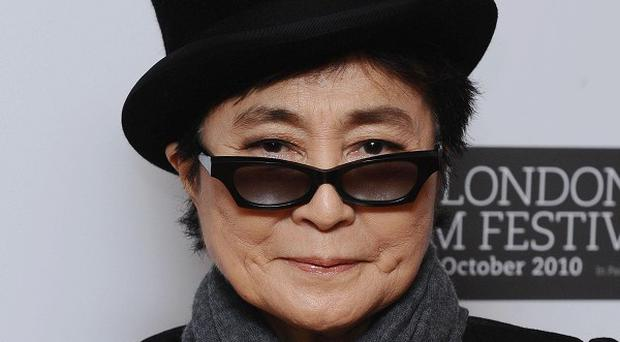 Yoko Ono has paid tribute to John Lennon and called for him to be remembered with 'deep love'