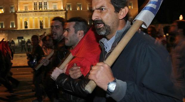 Protesters chant slogans against the Greek government's austerity measures outside the parliament in central Athens (AP)