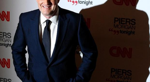 Piers Morgan arrives at the launch of CNN's Piers Morgan Tonight