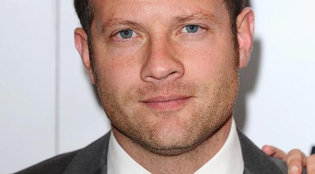 X Factor host Dermot O'Leary told viewers where they could download the singles of guest artists on the show
