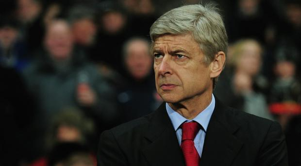 LONDON, ENGLAND - DECEMBER 08: Arsene Wenger manager of Arsenal looks on prior to the UEFA Champions League Group H match between Arsenal and FK Partizan Belgrade at the Emirates Stadium on December 8, 2010 in London, England. (Photo by Shaun Botterill/Getty Images)