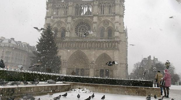 The Notre Dame cathedral in Paris is under a blanket of snow (AP)