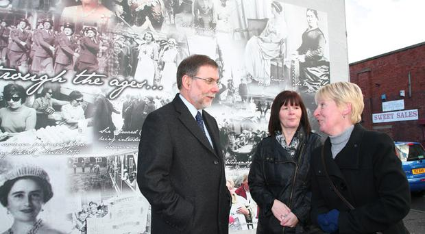Nelson McCausland with Alberta Robinson and Diane Little at the new mural in Enfield Street