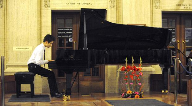 Cory Shen (16 years old) from Inst. Played piano at a Bar Council Sponsored concert in the Royal Court of Justice in aid of the Bars charities, Friends of the Cancer Centre and Perinatal Trust Fund.Photo by Simon Graham/Harrison Photography