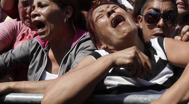 Distraught relatives of inmates gather at the San Miguel prison in Chile