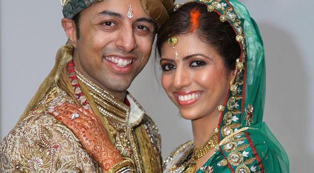 Shrien Dewani, pictured with his wife Anni, has appeared in court in the UK on an extradition warrant