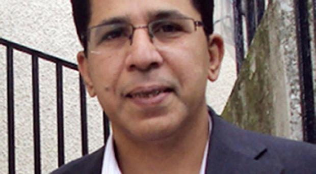 Detectives investigating the death of Imran Farooq are questioning a man on suspicion of murder